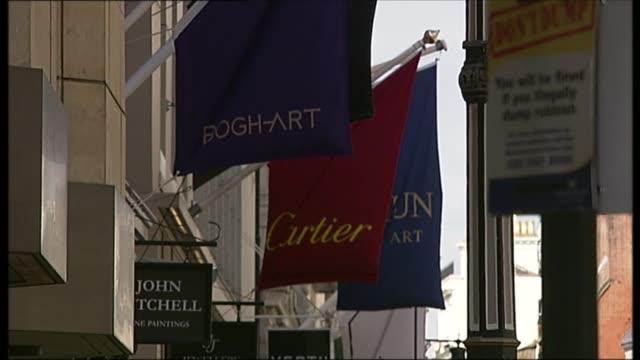 Row over Labour's plan to scrap 'nondom' tax status R14041412 London Old Bond Street Banner 'Dolce Gabbana' outside designer shop Advertisement...