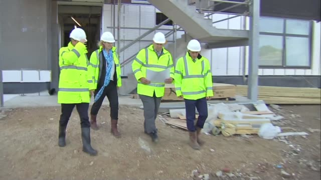 russell brand gives endorsement to labour england sussex ext david cameron at new road construction site cameron out of site office with others... - delia smith stock videos and b-roll footage