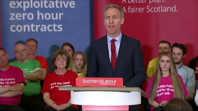 general election 2015: scottish labour party manifesto launched; scotland: glasgow: int various of jim murphy into room to applause to launch the... - all shirts stock-videos und b-roll-filmmaterial