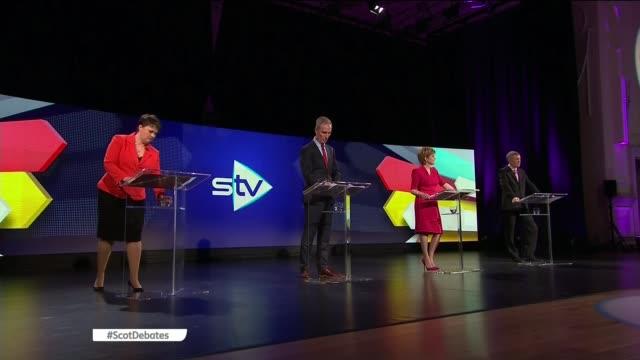 general election 2015: scottish leaders' debate; scotland: edinburgh: int nicola sturgeon , jim murphy , willie rennie and ruth davidson to podiums... - member of the scottish parliament stock videos & royalty-free footage