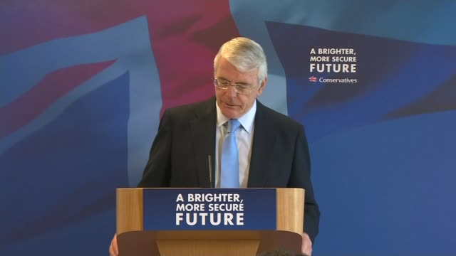 sir john major speech and reaction england west midlands solihull photography** sir john major arriving and taking seat in front row major sitting... - politics and government stock videos & royalty-free footage
