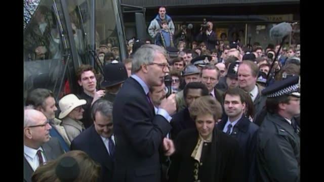 sir john major speech and reaction lib / england gloucestershire cheltenham cheltenham bus to john major making speech on soap box during election... - スクラム点の映像素材/bロール