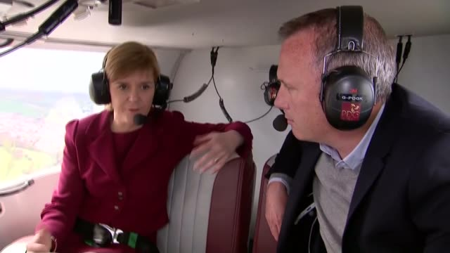 SNP maintain poll lead in Scotland as campaign continues SCOTLAND EXT Nicola Sturgeon walking across to helicopter carrying her picture and the...