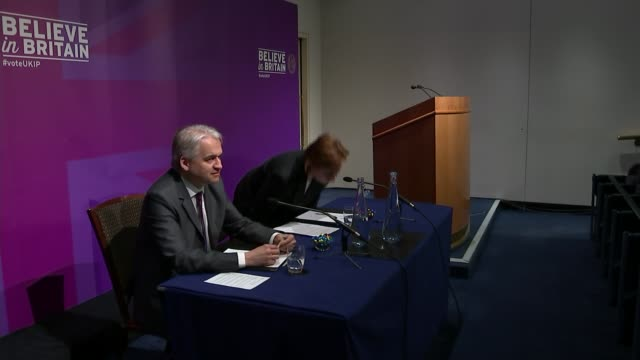 UKIP housing plans ENGLAND London INT Patrick O'Flynn and Suzanne Evans at UKIP press conference Audience Backdrop with slogan 'Believe in Britain'...