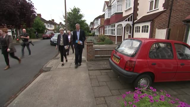 Campaigning in Richmond Park 2952017 Zac Goldsmith and Theresa May along street as campaigning together
