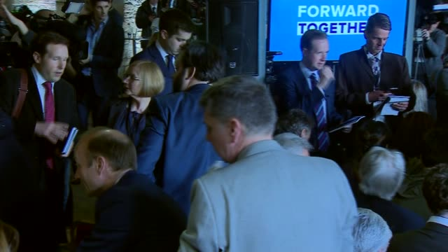 conservative party manifesto launch england west yorkshire halifax int **music heard sot** copies of conservative party manifesto being handed out to... - patrick mcloughlin stock videos and b-roll footage