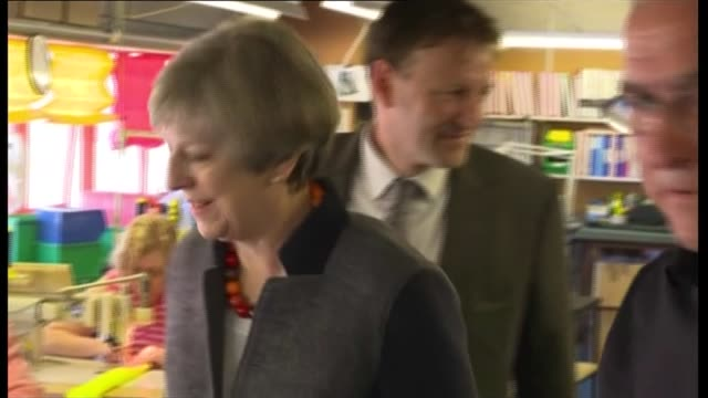 vídeos de stock e filmes b-roll de conservative theresa may campaigns in st austell england cornwall st austell ap diving int theresa may along in factory and meeting workers / various... - st austell