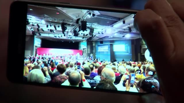 corbyn campaigns in birmingham / trident reassurance birmingham people at labour party rally seen on screen of mobile phone person videoing corbyn... - trident stock videos & royalty-free footage