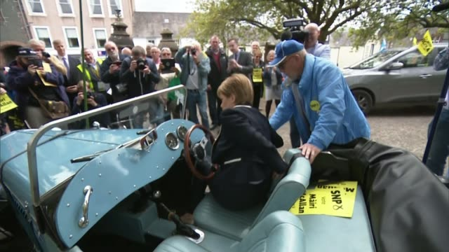 Debate over pensioners' winter fuel payments dominates the day Location unknown EXT Nicola Sturgeon MSP getting in vintage car and sitting at wheel...