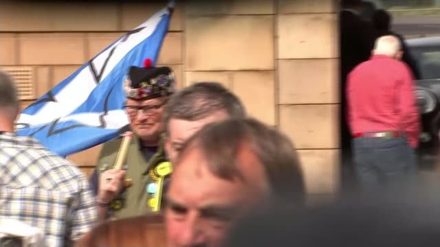 final day of campaign Scotland Leith Nicola Sturgeon MSP onto stage surrounded by cheering supporters Man with 'Yes' saltire scottish flag Nicola...