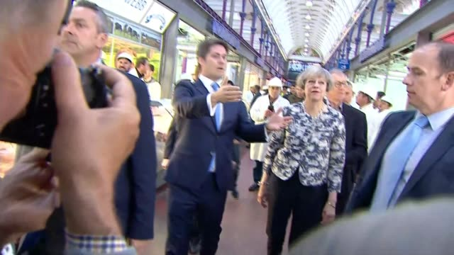 final day of campaigning england london smithfield market int various shots of theresa may and her husband philip may talking with stallholders as... - norwich england bildbanksvideor och videomaterial från bakom kulisserna