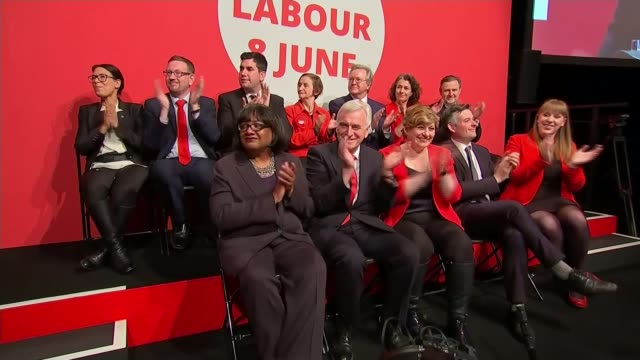final day of campaigning Labour DATE ENGLAND London EXT Diane Abbott MP applauding beside Shadow Chancellor John McDonnell Labour Leader Jeremy...