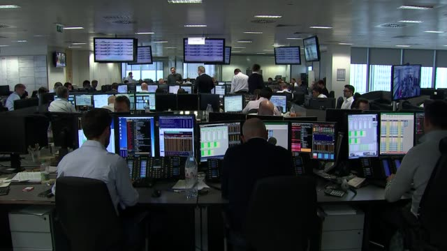 hung parliament business reaction as value of pound falls england london int various of bcg trading floor with traders shouting from desks and on... - stock trader stock videos and b-roll footage