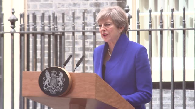 hung parliament cutaways of theresa may downing street statement england london downing street ext steps of no 10 / car carrying theresa may away /... - hanging stock videos & royalty-free footage