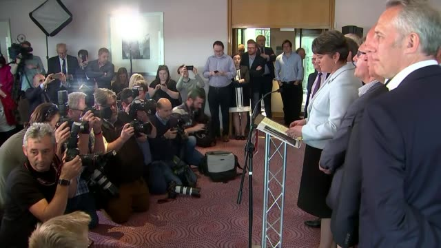 general election 2017: hung parliament: northern ireland results; northern ireland: belfast: int arlene foster into press conference with other ten... - hanging stock videos & royalty-free footage