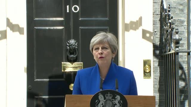 Hung parliament Theresa May Downing Street statement ENGLAND London Downing Street EXT Convoy of cars arrives / Theresa May MP and husband Philip May...
