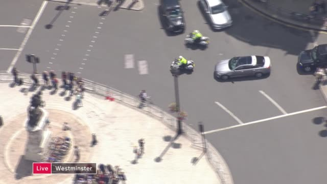 hung parliament theresa may to form new government air view motorcade carrying theresa may from buckingham palace to downing street - motorcade stock videos & royalty-free footage