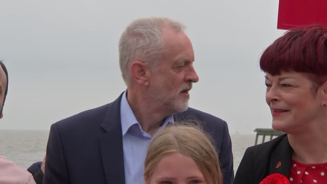 general election 2017: jeremy corbyn campaigns in lowestoft; jeremy corbyn , sonia barker and labour supporters along seafront / corbyn and barker... - ローストフト点の映像素材/bロール