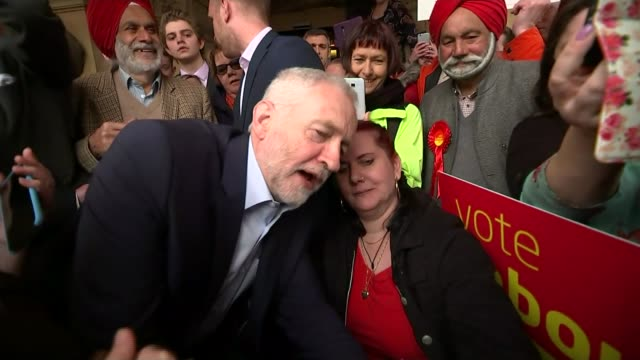 jeremy corbyn profile lib / 852017 warwickshire leamington spa corbyn posing for photograph with woman and saying smile now sot - leamington spa stock videos & royalty-free footage