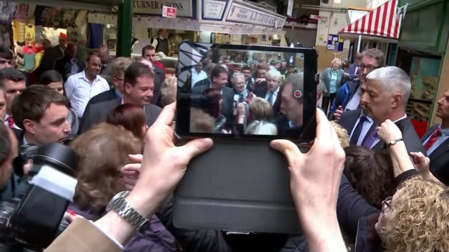 vídeos y material grabado en eventos de stock de johnson campaigns in south wales wales newport boris johnson interview sot johnson along through market surrounded by people tablet computer being... - rodear
