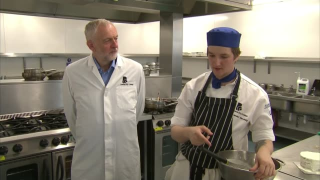 Labour and Liberal Democrats promise more schools spending ENGLAND Leeds INT Jeremy Corbyn in college kitchen chatting with chef Sponge cake spread...