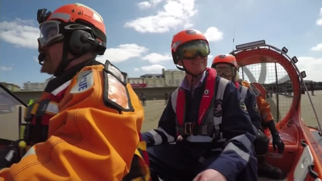 liberal democrats and green party campaigning england somerset burnhamonsea ext liberal democrat leader tim farron along on hovercraft wearing helmet... - hovercraft stock videos & royalty-free footage