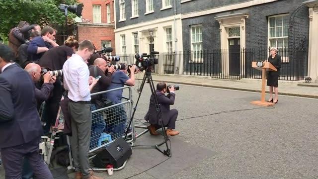 general election 2017 / london bridge attack politicians suspend campaigning london downing street cutaways theresa may speech theresa may along into... - ダウニング街点の映像素材/bロール