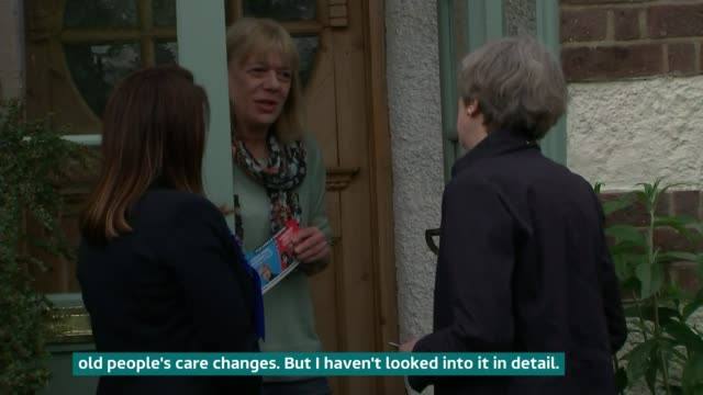 may on defensive about changes to social care england london ealing ext woman on doorstep talking to prime minister theresa may about proposed... - itv weekend late news点の映像素材/bロール