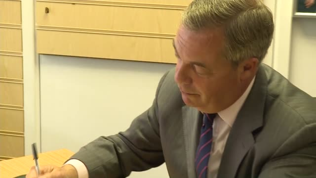 Nigel Farage in Thanet ENGLAND Essex Thanet EXT GVs Nigel Farage MEP arrival / UKIP supporters Nigel Farage in office / Tim Aker NEP in office EXT...