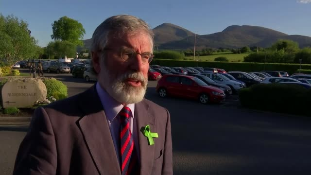 general election 2017: northern ireland campaign; northern ireland: county down: newcastle ext waves washing ashore sea with houses on shore behind... - jack hanna stock-videos und b-roll-filmmaterial