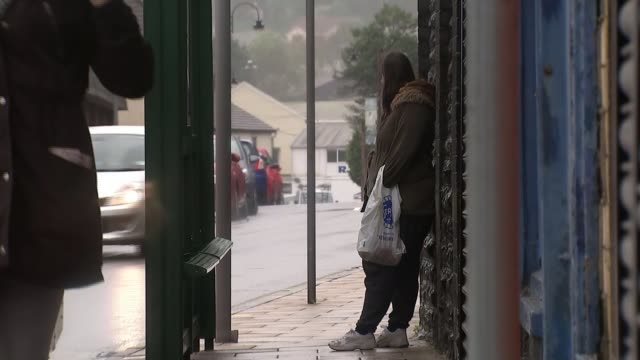 plaid cymru unveil manifesto rhondda valley ext reporter to camera woman beside bus stop as rains street of terraced houses vox pops leanne wood am... - plaid stock videos and b-roll footage