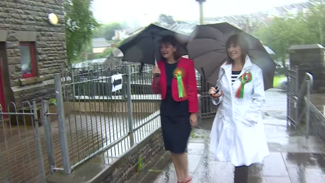 vídeos de stock, filmes e b-roll de polling day / security reviewed at polling stations cumbria kendal liberal democrat leader tim farron arriving to vote leanne wood arriving to vote... - marido