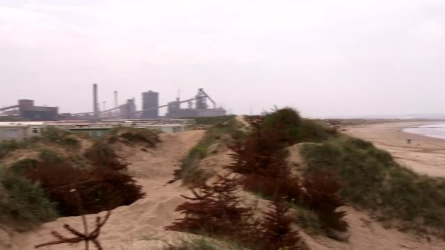 redcar case study england north yorkshire redcar overlay interviewees** wide of beach people throwing stones into sea gv beach pan to closed down ssi... - closed sign stock videos and b-roll footage