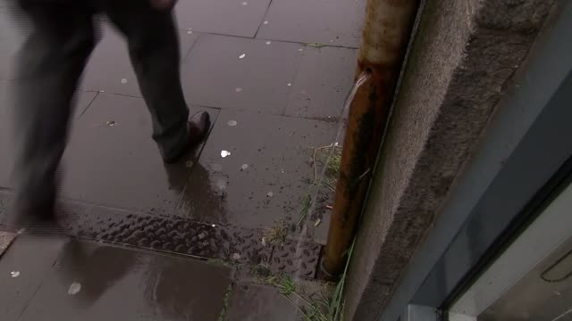 general election 2017: snp campaign; scotland: aberdeen: ext ** music overlaid over following sequence *** puddles as rain falls water from pipe... - pavement点の映像素材/bロール