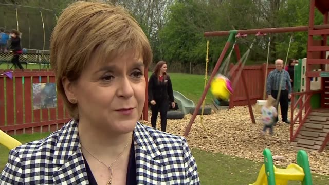 snp nicola sturgeon interview and visit to children's playground scotland aberdeenshire ext nicola sturgeon msp interview sot / various shots of... - aberdeenshire stock videos & royalty-free footage