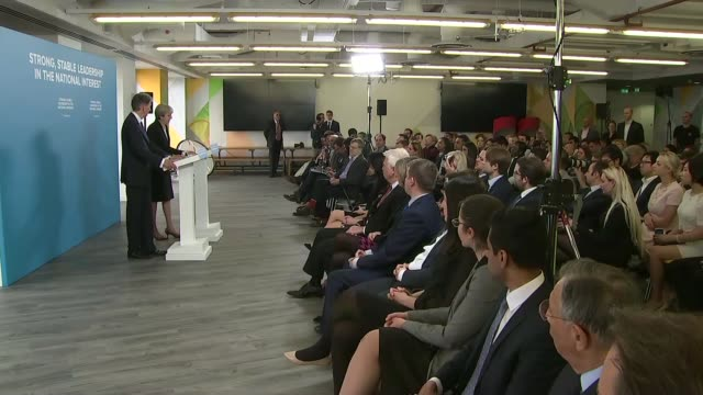 theresa may and philip hammond press conference cutaways england london canary wharf int theresa may and philip hammond arrival at podiums for press... - cufflink stock videos & royalty-free footage