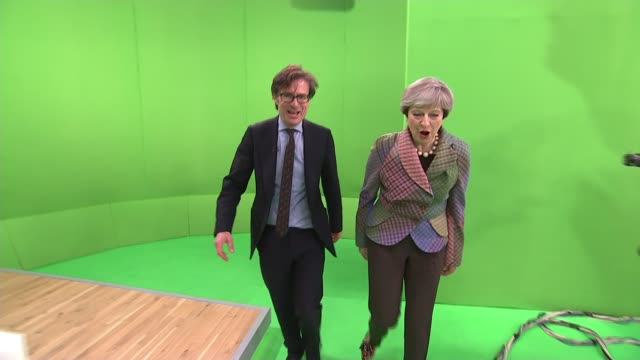 general election 2017: theresa may answers facebook live questions from public; england: london: gir: int theresa may along into green-screen studio... - chroma key stock videos & royalty-free footage