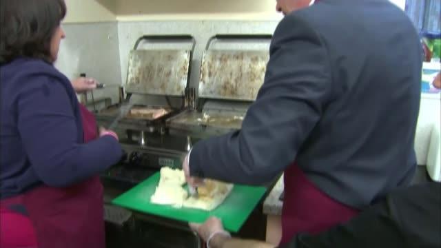Theresa May campaigns in Edinbugh Edinburgh INT Tim Farron along putting on apron in cafe Tim Farron cooking breakfast in cafe Tim Farron along...