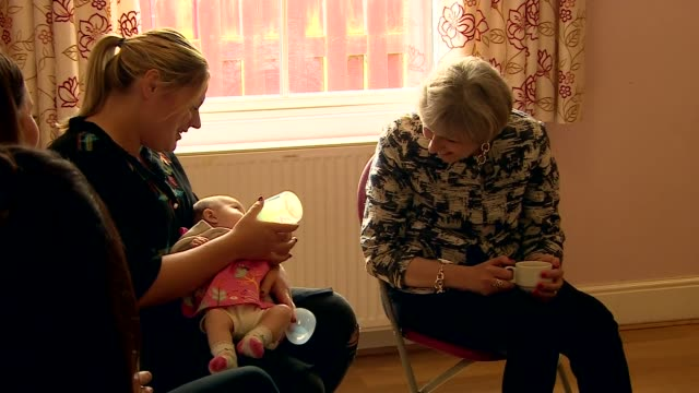 theresa may meets mothers in doncaster england south yorkshire doncaster photography*** theresa may chatting with mothers and children - theresa may stock-videos und b-roll-filmmaterial
