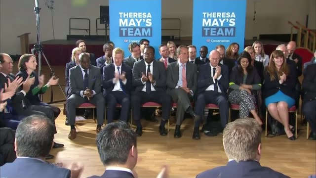 theresa may pledges to reduce net migration to the tens of thousands england london harrow int patrick mcloughlin introducing theresa may to applause... - harrow stock videos & royalty-free footage