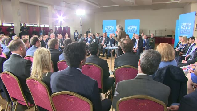 theresa may pledges to reduce net migration to the tens of thousands england london harrow int various shots theresa may along into room as tory... - harrow stock videos & royalty-free footage