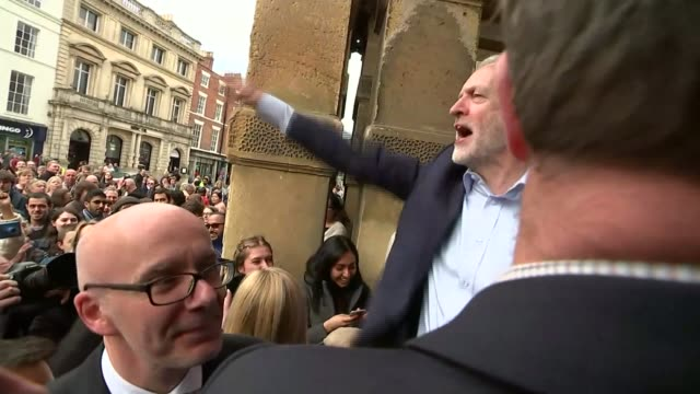 general election 2017: theresa may pledges to reduce net migration to the tens of thousands; warwickshire: leamington spa: man offers jeremy corbyn... - east anglia stock videos & royalty-free footage