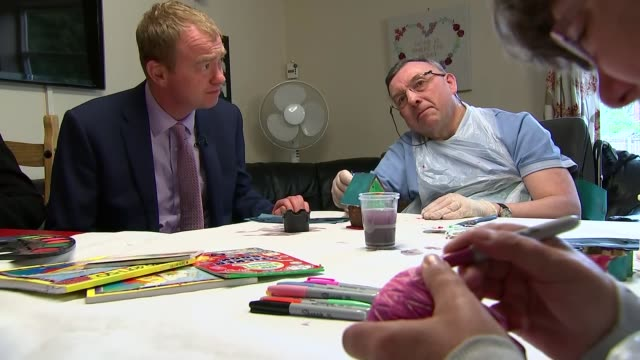 stockvideo's en b-roll-footage met tim farron in southport england merseyside southport int tim farron arriving at care home / farron chatting to people around table in care home - southport engeland