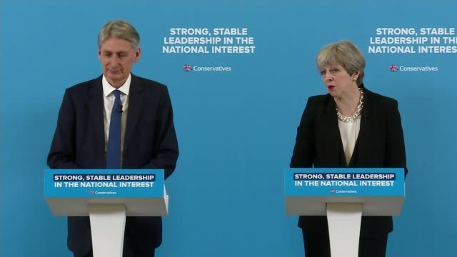 Tories prepare for manifesto launch amid talk of tensions between May and Hammond ENGLAND London Canary Wharf INT Theresa May press conference SOT...
