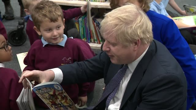 boris johnson primary school visit england somerset taunton int boris johnson entering classroom / boris johnson reading with schoolchildren - education stock videos & royalty-free footage