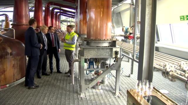 boris johnson visits roseisle distillery scotland morayshire near elgin roseisle distillery int various shots of boris johnson touring roseisle... - scotch whiskey stock videos and b-roll footage