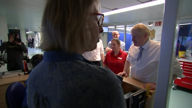 boris johnson visits west cornwall hospital ** intermittent england cornwall penzance west cornwall hospital int boris johnson along corridor and... - shirt and tie stock videos & royalty-free footage