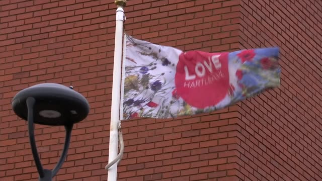 brexit party sacks officials after evidence of racism uncovered england hartlepool ext gv flag flying 'love hartlepool' gv harbour wall and waves... - racism stock videos & royalty-free footage