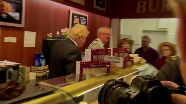 conservative pledge to 'lower' immigration levels england somerset glastonbury int various shots of boris johnson behind counter in bakery and... - cream cake stock videos & royalty-free footage