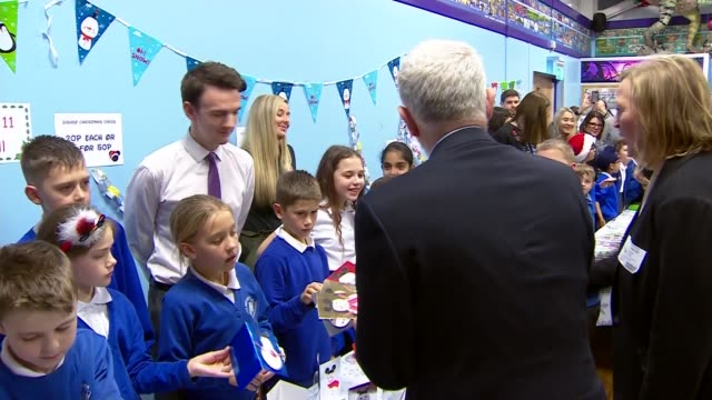 general election 2019: jeremy corbyn visits junior school in west midlands; england: west midlands: walsall: new invention junior school: int various... - public celebratory event stock videos & royalty-free footage